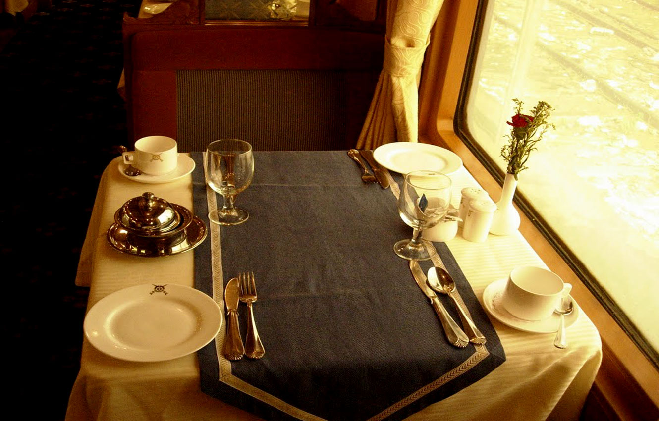 A table set for high tea on the board Deccan Odyssey
