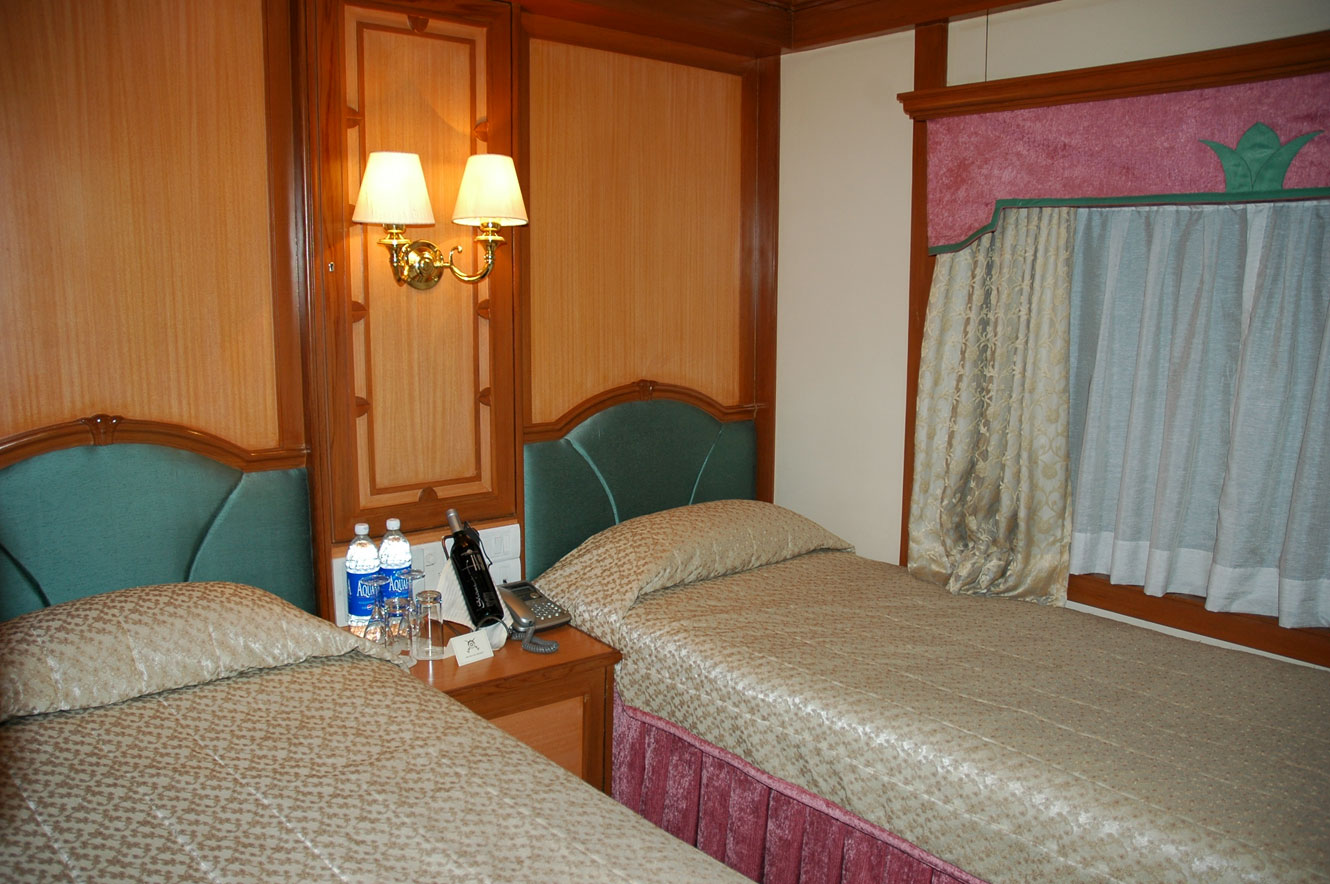 A twin bed cabin on board The Deccan Odyssey