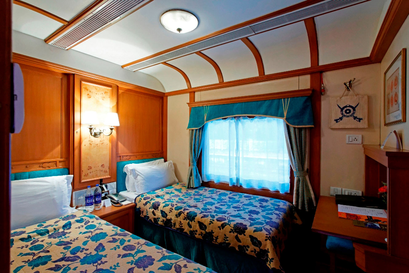 A twin bed deluxe cabin on board The Deccan Odyssey